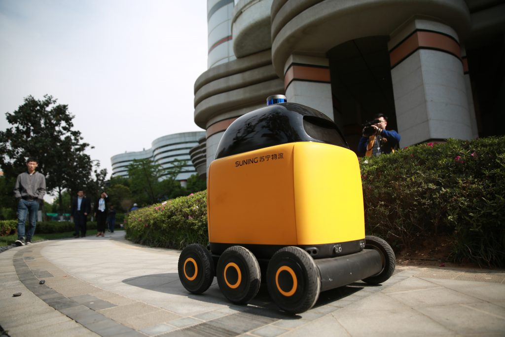 Suning launches its first autonomous robot to delivery parcels in residential area